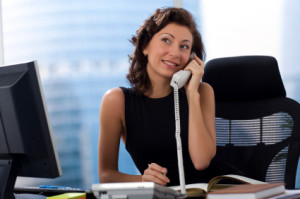 woman on desk phone